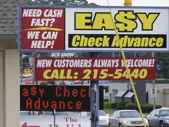 "Payday loan stores seen in Montgomery in 2014. Advocates of reform are pushing a ""30-days-to-pay"" bill, extending the time needs to pay off short-term loans."