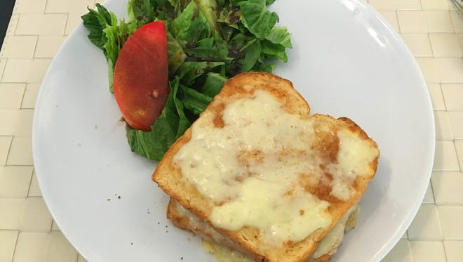 Croque monsieur is a double-cheese topped ham sandwich, worth getting out the fork and knife for. Photo by J.C. Heithaus