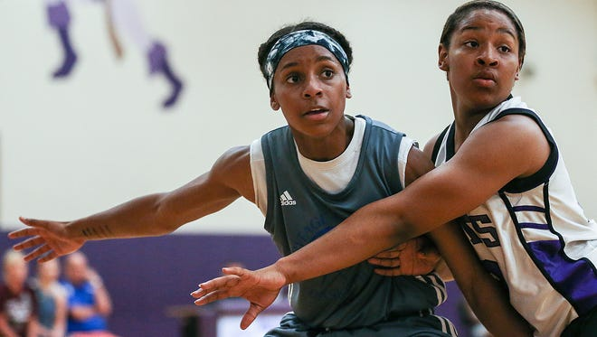 Ari Wiggins, left, plays in a summer league game at Ben Davis High School, Indianapolis, Thursday, June 22, 2017. The 14-year-old basketball standout is a freshman at Heritage Christian School this fall 2017 and has already received scholarship calls from Butler and Indiana University. Several other colleges across the country have expressed interest in Wiggins before she has even stepped foot in a high school game.