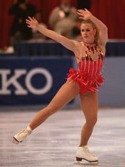 [Harding serious]Caption: Tanya Harding skating and