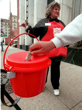 Bell ringer Melanie Lease works a kettle in 1998 in Morgantown, W.Va., a town hit annually by a generous secret donor.
