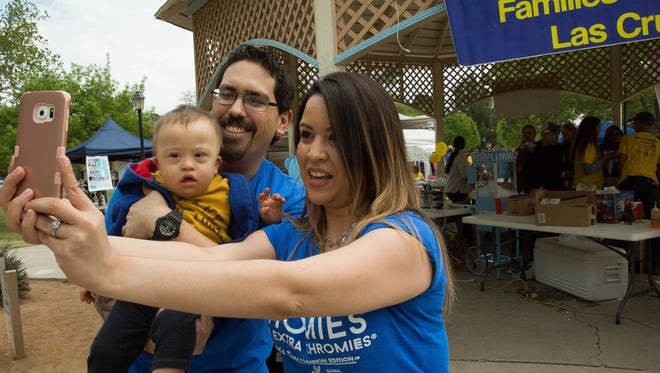 Maribel Aguirre,right, husband Sam Aguirre and Sam Aguirre Jr. take a family selfie at the Buddy Day event at Pioneer Park, Saturday, April 1, 2017. Buddy Day was started to help celebrate World Down Syndrome Day which was on March 21. The event hosted games,face painting, food and other activities.