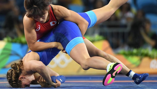 In this file photo, Kaori Icho, in red, and Valeriia Koblova Zholobova compete in a women's freestyle 58kg gold wrestling medal match at Carioca Arena 2 during the Rio 2016 Summer Olympic Games.