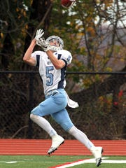 West Morris receiver Willie Ruppel pulls in a long pass for a touchdown vs. Morris Hills during their Saturday football matchup. November 7, 2015, Rockaway, NJ.