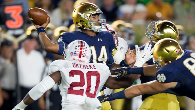 Notre Dame Fighting Irish quarterback DeShone Kizer (14) throws as Stanford Cardinal linebacker Bobby Okereke (20) pressures in the first quarter at Notre Dame Stadium.