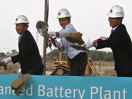From left, LG Group Chairman Koo Bon-moo, Michigan Gov. Jennifer Granholm and LG Chem CEO Peter Bahn-Suk Kim break ground on the new LG Chem plant that will manufacture advanced batteries for Chevrolet and Ford electric cars, Thursday, July 15, 2010, in Holland, Mich.