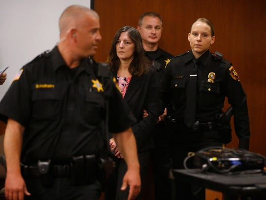 Michelle Lodzinski enters the courtroom before the jury announces she is guilty of the first-degree murder of her son. Lodzinski was charged with the murder of her 5-year-old son, Timothy Wiltsey, 25 years ago. The trial was before Superior Court Judge Dennis Nieves at the Middlesex County courthouse in New Brunswick.