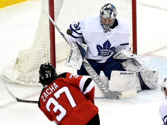 New Jersey Devils center Pavel Zacha (37) gets a shot past Toronto Maple Leafs goaltender Frederik Andersen (31) for the Devils' first goal of the second period. The Devils defeated the Maple Leafs 2-3 at the Prudential Center in Newark, NJ on Thursday, April 5, 2018.
