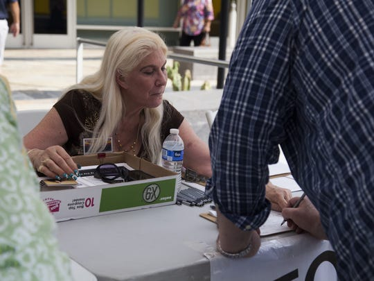Arizona Gov. Doug Ducey has signed into law a bill that bans the paying of circulators for each signature they collect for citizen-initiative campaigns.