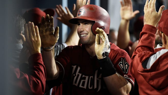 Jun 10, 2015: Arizona Diamondbacks first baseman Paul Goldschmidt (44) is congratulated in the dugout after hitting a two run home run in the fifth inning against the Los Angeles Dodgers during the game at Dodger Stadium.
