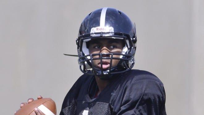 Junior college transfer Dontreal Pruitt is battling for the Troy starting quarterback job.