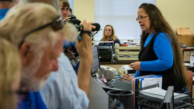 Rowan County Clerk Kim Davis, right, argues with David Moore and David Ernold, after they were denied a marriage license at the Rowan County Courthouse in Morehead.
