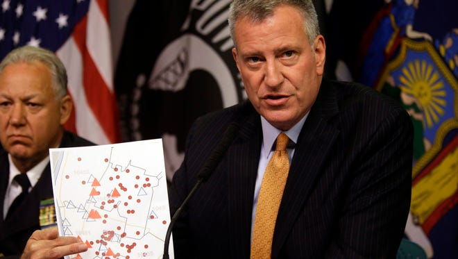 New York City Mayor Bill de Blasio holds a map showing the location in the Bronx borough of cooling towers, red triangles, and people, red dots, that were infected with Legionnaires' disease during a news conference to provide an update of the Legionnaires' disease outbreak. Twelve people have died amid the largest outbreak of Legionnaires' disease in New York City's history. (AP Photo/Mary Altaffer) ORG XMIT: NYMA101