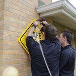 Firefighters added a Safe Place sign to a station in West Lafayette. The program is designed to give youths a place to ask for help.
