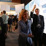 Debbie Wasserman Schultz, chair of the Democratic National Committee, greets people as she enters the Spin Room after the Democratic presidential debate at Drake University on Saturday, Nov. 14, 2015, in Des Moines.