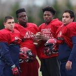 From left rear, Stepinac's Khaleb Celaj, Antonio Giannico, David Harris, and Tyquell Fields, will face Cardinal Hayes this Saturday night in the championship game at Fordham University. They are photographed before practice at Archbishop Stepinac High School in White Plains Nov 18, 2015.