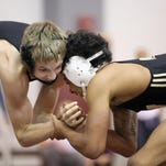 Warren Central and Perry Meridian battled it out for Marion County supremacy on the mat Saturday.