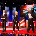 Democratic presidential candidates stand together before the start of the debate Jan. 17, 2016, in Charleston, S.C.