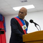 Haiti's President Michel Martelly pauses during his speech to Parliament in Port-au-Prince, Haiti, on Sunday, Feb. 7, 2016. Martelly made his farewell address to Parliament Sunday, leaving office with no leader yet chosen to fill the void left by his departure. Lawmakers are beginning a process to patch together a short-term interim government.