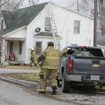 Randolph Township fire fighters respond to a house fire Monday in Romney.