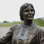 Keosauqua artist Chris Bennett makes some adjustments to his bronze statue of Lou Henry Hoover in Waterloo.