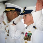 U.S. Coast Guard Lt. Commander Molly Waters salutes on stage before relieving Commander Justin Kimura of his duty as Commanding Officer of the U.S. Coast Guard Cutter Hollyhock during a change of command ceremony Friday, June 17, 2016 in Port Huron.