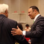 Marc Morial, president and CEO of the National Urban League greets people during a luncheon at the Hyatt Hotel in Cincinnati Wednesday  July 23, 2014. Wednesday is the first day of the Urban League's national conference. The Enquirer/Cara Owsley