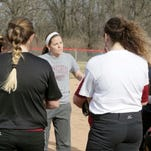 McCutcheon catcher Amber Antczak fires the ball to first base during Monday's practice.