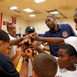NBA player Elton Brand huddles with a group during the Elton Brand youth basketball clinic on Saturday at Peekskill High School. Brand, a former Peekskill High School star, is a free agent in the twilight of his NBA career.