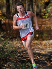 Piketon's Seth Farmer competes at the regional cross