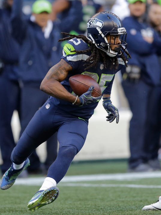 FILE - In this Oct. 29, 2017, file photo, Seattle Seahawks cornerback Richard Sherman (25) runs after he intercepted a pass rom Houston Texans quarterback Deshaun Watson late in the second half of an NFL football game in Seattle. Sherman signed a three-year deal with the San Francisco 49ers on Sunday, March 11, 2018, two days after being released by the rival Seahawks. (AP Photo/Stephen Brashear, File)