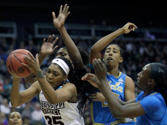 Mississippi State guard Victoria Vivians (35) rebounds against UCLA forwards Monique Billings, second from right, and Michaela Onyenwere, right, during the first half of a women's NCAA college basketball tournament regional final game, Sunday, March 25, 2018, in Kansas City, Mo. (AP Photo/Orlin Wagner)