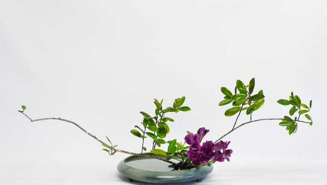 A classic ikebana sits on display in Minh HŠusler's home studio on Friday, Feb. 3, 2017 in Naples, Florida. Ikebana is the Japanese art of living flower arrangement where nature and humanity are brought together.