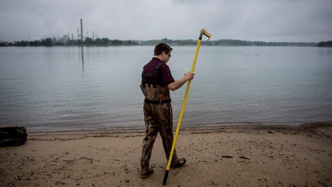 St. Clair County Health Department Environmental Health Aid Adam Czubachowski, 19, of Port Huron, prepares to take a water sample to test for E. coli Thursday, May 25, 2017 at Chrysler Beach in Marysville.