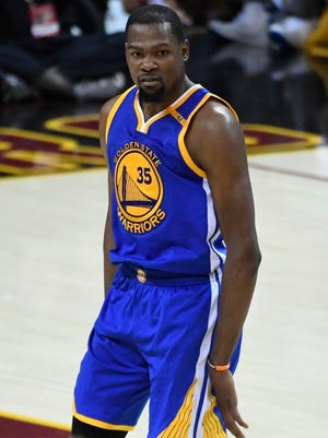 Kevin Durant celebrates after making a three-point basket during the fourth quarter in Game 3 of the NBA Finals.
