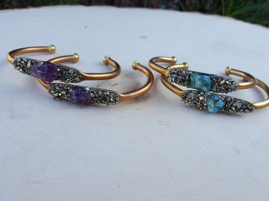 Crushed Pyrite and Amethyst Cuff bracelets (left) and Crushed Pyrite and Apatite Cuff bracelets by Ophelia Moon for $34.