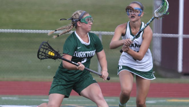 Yorktown's Casey Duff is guarded by Minisink Valley's Nora Hanlon during their lacrosse sub-regional at Dietz Stadium in Kingston June 1, 2016.