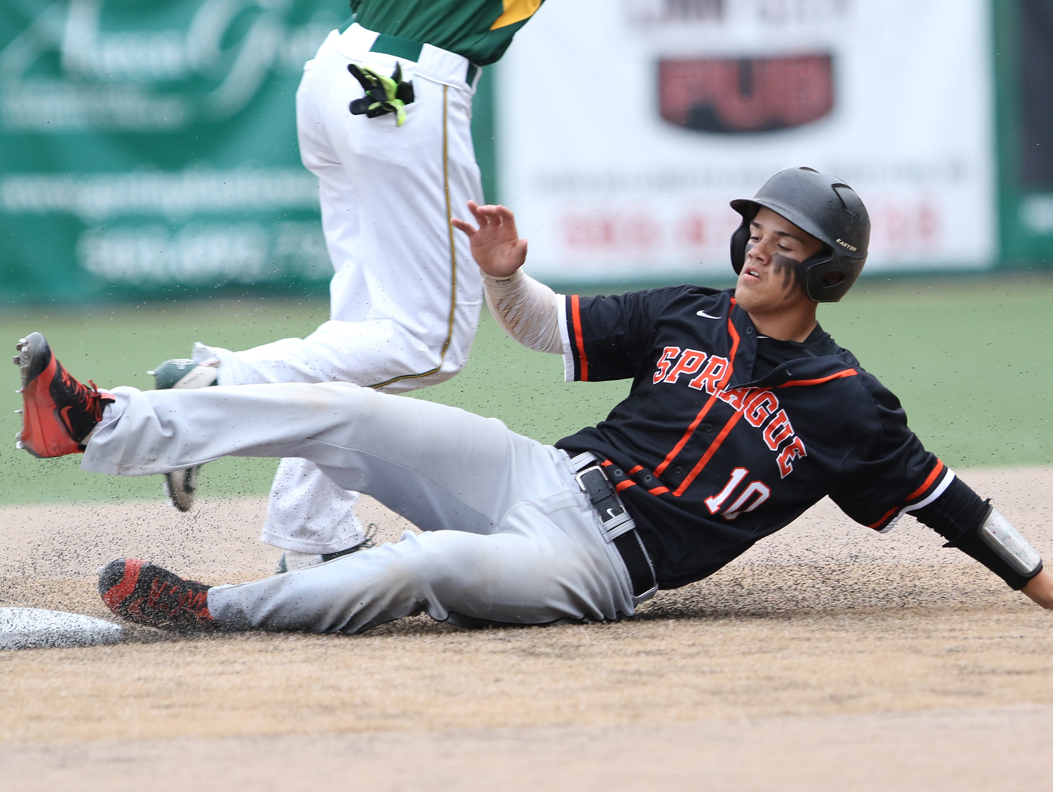 Sprague's Justin Culpepper slides to second base as the Olympians fall to West Linn 5-3 in second round of OSAA 6A state playoffs on Wednesday, May 25, 2016, at West Linn High School.