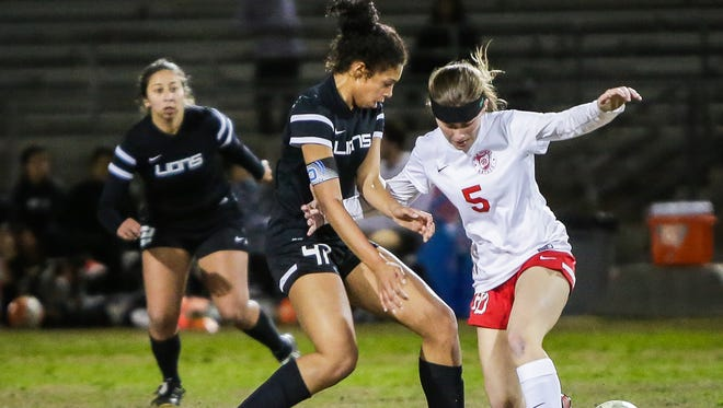Azalea Guanajuato attempts to steal the ball. Palm Desert beats Cathedral City during their home game 5-3.