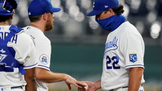 Kansas City Royals relief pitcher Ian Kennedy, second from left, hands the ball to manager Mike Matheny after being removed in the seventh inning Saturday during a 7-2 loss to the Minnesota Twins at Kauffman Stadium.