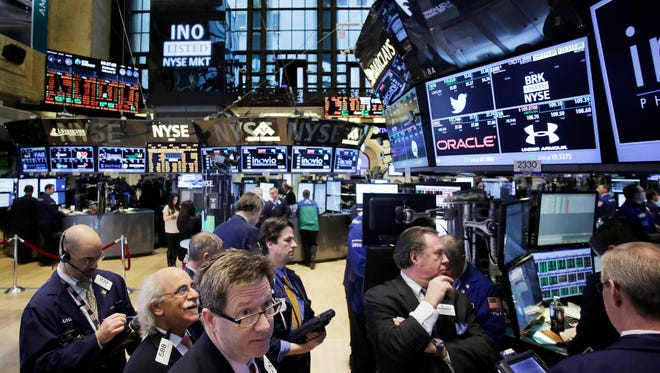 Traders monitor stock prices at the New York Stock Exchange on Feb. 12.