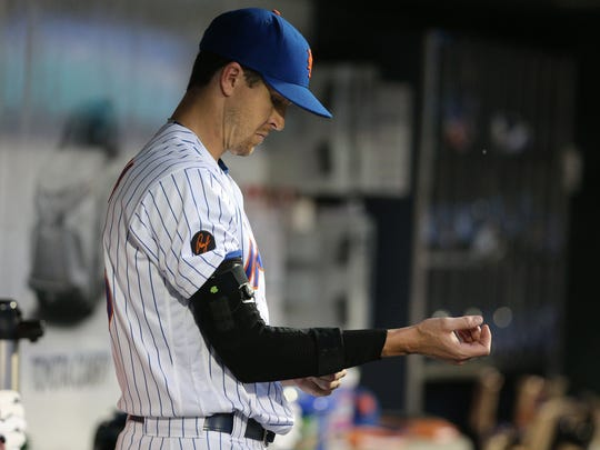 New York Mets starting pitcher Jacob deGrom (48) puts a brace on his pitching arm before batting against the Miami Marlins during the fourth inning at Citi Field on May 23, 2018.