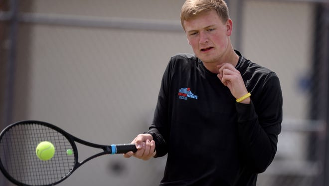 Lincoln's Aidan DeBoer returns the ball to Madison's Marcus VandenBosch during the Madison Triangular at Kuehn Park Tennis Courts on Tuesday.