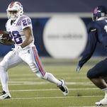 Louisiana Tech Bulldogs running back Kenneth Dixon (28) carries the ball as Rice Owls safety JT Ibe (17) defends at Rice Stadium earlier this season.