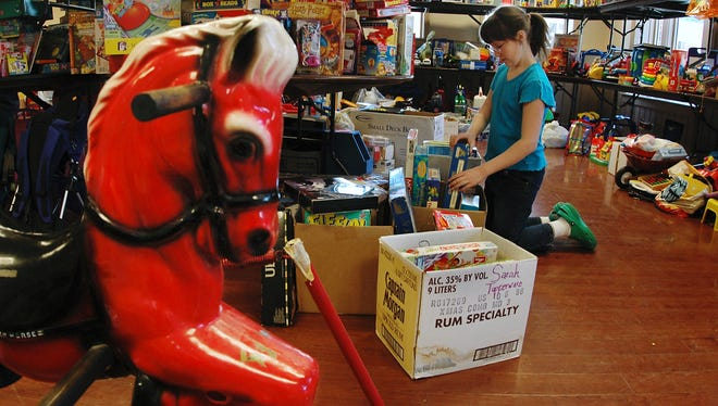 Kiera Hoenig,10,  organizes toys for the annual Saint's Place sale in 2006.
