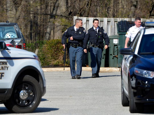 Police from several area departments search for two