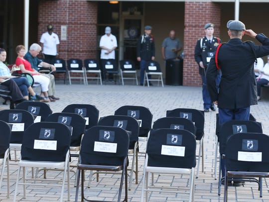 A Montgomery Central High School JROTC member salutes