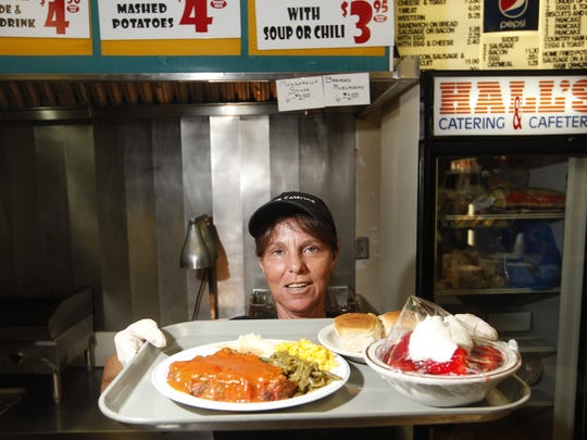 Regina Hagan among the life long employees at Hall's Cafeteria serving the special: meatloaf, mashed potatoes, green beans, corn, rolls, and strawberry shortcake.  (Kylene Lloyd, The Courier-Journal) May 24, 2011
