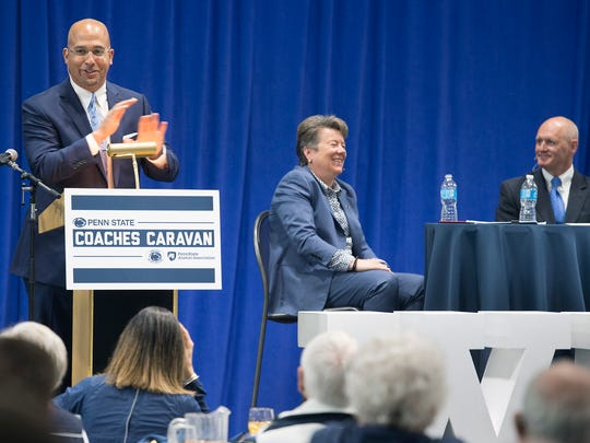 James Franklin, head football coach, left, answers questions from fans during the PSU coaches caravan at Penn State York.