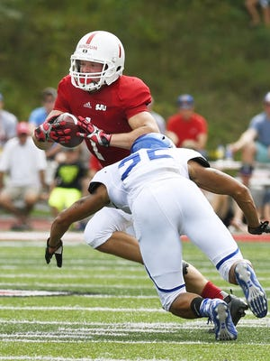 St. John's wide receiver Josh Bungum breaks away from Dubuque's Oscar White in the first half of a season-opening victory over the Spartans. Now Bungum and company will play host to Dubuque again in the first round of the Division III playoffs at noon Saturday in Collegeville. St. John's Josh Bungun breaks away from a tackle attempt by University of  Dubuque'sOscar White in the first half Saturday in Clemens Stadium.